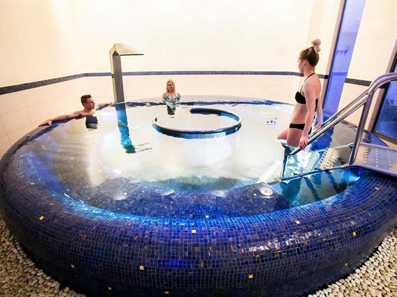 Three people in circle spa