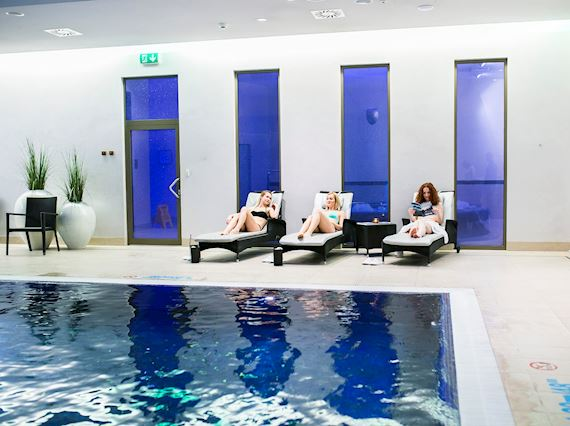 three ladies relaxing near pool