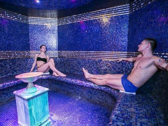couple in aromatic steam room